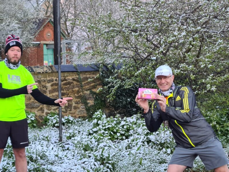 Runners preparing for their run on cake night in the snow